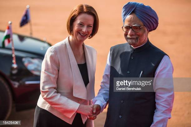 Australian Prime Minister Julia Gillard poses with Indian Prime Minister Manmohan Singh during her ceremonial reception at the Indian presidential...