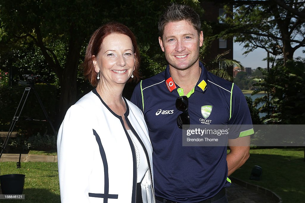 Australian Prime Minister, Julia Gillard poses with Michael Clarke of Australia during a function at Kirribilli House on January 1, 2013 in Sydney, Australia.