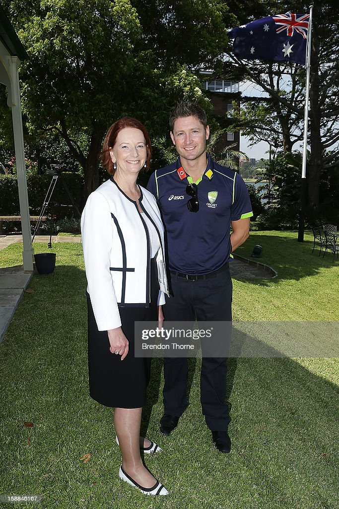 Australian Prime Minister, <a gi-track='captionPersonalityLinkClicked' href=/galleries/search?phrase=Julia+Gillard&family=editorial&specificpeople=787281 ng-click='$event.stopPropagation()'>Julia Gillard</a> poses with Michael Clarke of Australia during a function at Kirribilli House on January 1, 2013 in Sydney, Australia.