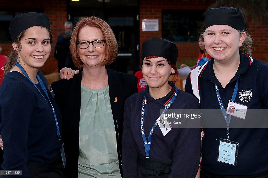 Australian Prime Minister Julia Gillard poses with students at Thornlie Senior High School on March 27, 2013 in Perth, Australia. Gillard held a community cabinet meeting with members of her new front bench in the suburb of Thornlie today, in her first visit to WA since the Labor party lost state elections.