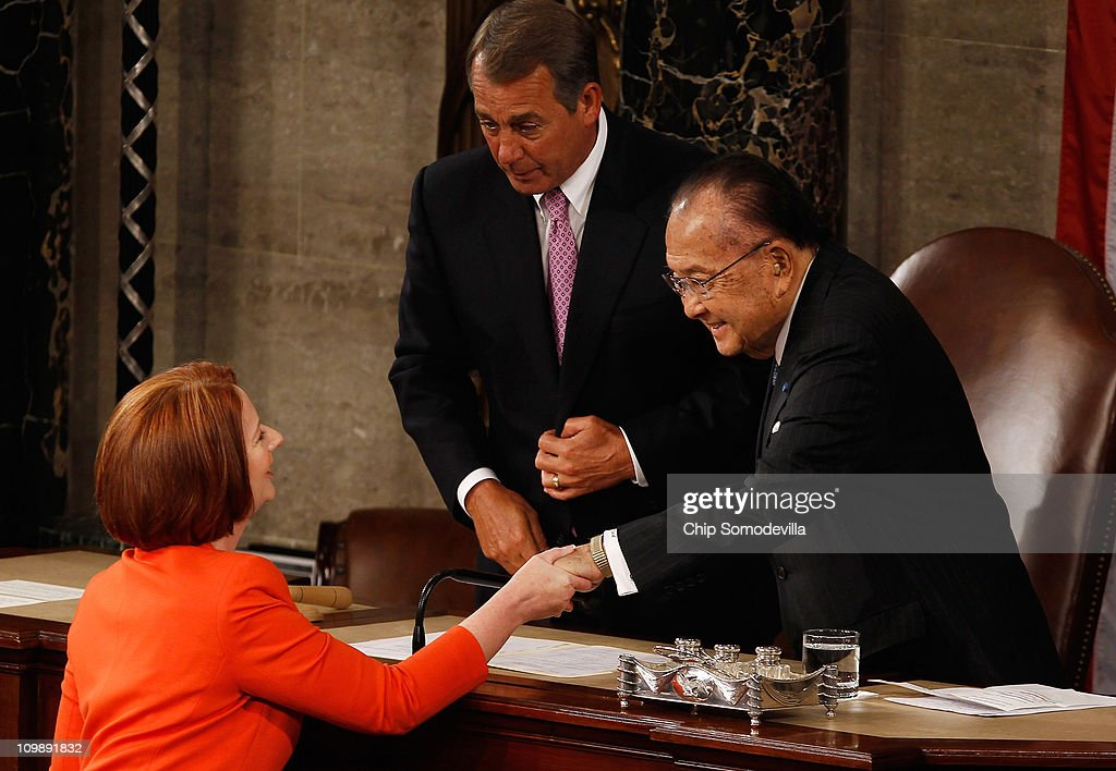 Australian Prime Minister <a gi-track='captionPersonalityLinkClicked' href=/galleries/search?phrase=Julia+Gillard&family=editorial&specificpeople=787281 ng-click='$event.stopPropagation()'>Julia Gillard</a> (L) shakes hands with Speaker of the House <a gi-track='captionPersonalityLinkClicked' href=/galleries/search?phrase=John+Boehner&family=editorial&specificpeople=274752 ng-click='$event.stopPropagation()'>John Boehner</a> (R-OH) (C) and Senate President Pro Tempore Daniel Inouye (D-HI) after she addressed a joint meeting of the U.S. Congress from the floor of the House of Representatives at the U.S. Capitol March 9, 2011 in Washington, DC. Gillard emphasized the long and strong bond between her country and the United States.