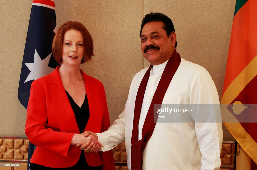 Australian Prime Minister <a gi-track='captionPersonalityLinkClicked' href=/galleries/search?phrase=Julia+Gillard&family=editorial&specificpeople=787281 ng-click='$event.stopPropagation()'>Julia Gillard</a> shakes hands with Sri Lanka President <a gi-track='captionPersonalityLinkClicked' href=/galleries/search?phrase=Mahinda+Rajapaksa&family=editorial&specificpeople=588377 ng-click='$event.stopPropagation()'>Mahinda Rajapaksa</a> during a bilateral summit ahead of the Commonwealth Heads of Government meeting (CHOGM) on October 26, 2011 in Perth, Australia. Commonwealth Heads of Government Meeting will be opened by Queen Elizabeth II on Friday whilst she is on her official visit to Australia.