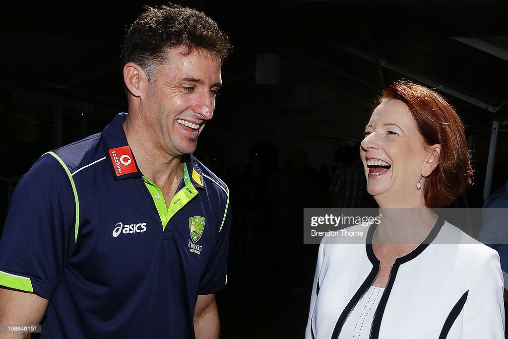 Australian Prime Minister, Julia Gillard shares a joke with Michael Hussey of Australia during a function at Kirribilli House on January 1, 2013 in Sydney, Australia.