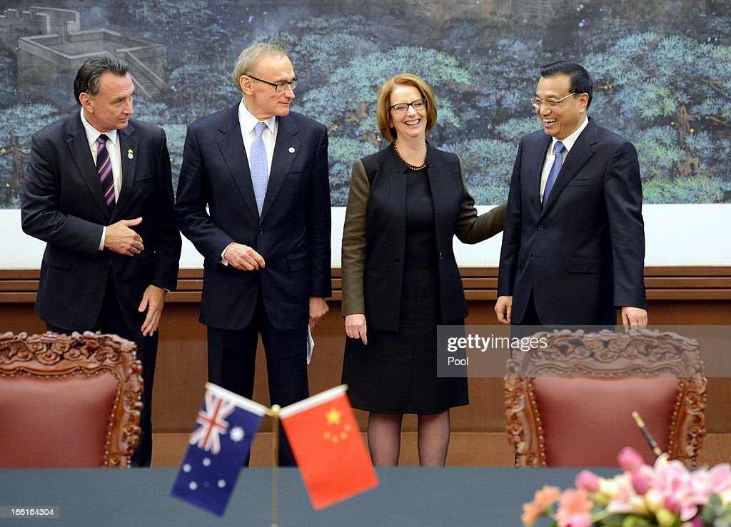 Australian Prime Minister Julia Gillard (2nd from R) shares a laugh with Chinese Premier Li Keqiang during a meeting at the Great Hall of the People on April 9, 2013 in Beijing, China. Gillard spoke of building stronger defense ties with China.