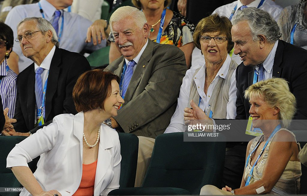 Australian Prime Minister Julia Gillard (2L) shares a light moment with former tennis champion Margaret Court (2R) and others in a break in the semi-final men's singles match between Novak Djokovic of Serbia and Andy Murray of Britain on the twelfth day of the Australian Open tennis tournament in Melbourne on January 27, 2012. IMAGE