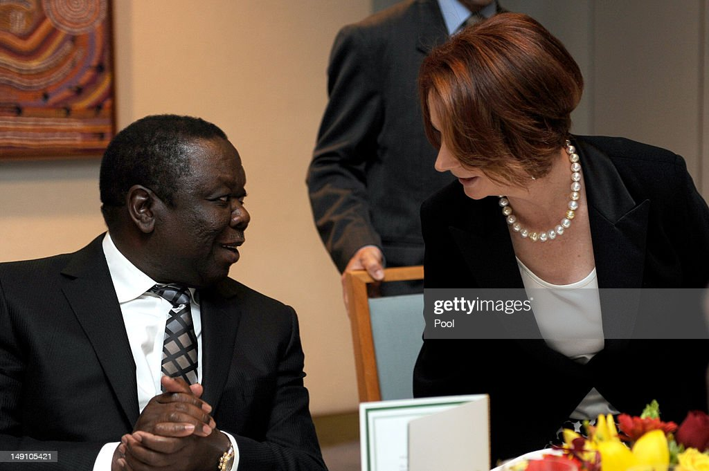 Australian Prime Minister <a gi-track='captionPersonalityLinkClicked' href=/galleries/search?phrase=Julia+Gillard&family=editorial&specificpeople=787281 ng-click='$event.stopPropagation()'>Julia Gillard</a> speaks with the Prime Minister of Zimbabwe <a gi-track='captionPersonalityLinkClicked' href=/galleries/search?phrase=Morgan+Tsvangirai&family=editorial&specificpeople=800701 ng-click='$event.stopPropagation()'>Morgan Tsvangirai</a> during a lunch on July 23, 2012 in Canberra, Australia. Australia is the third largest donor to Zimbabwe with assistance focused on water, sanitation and economic growth.