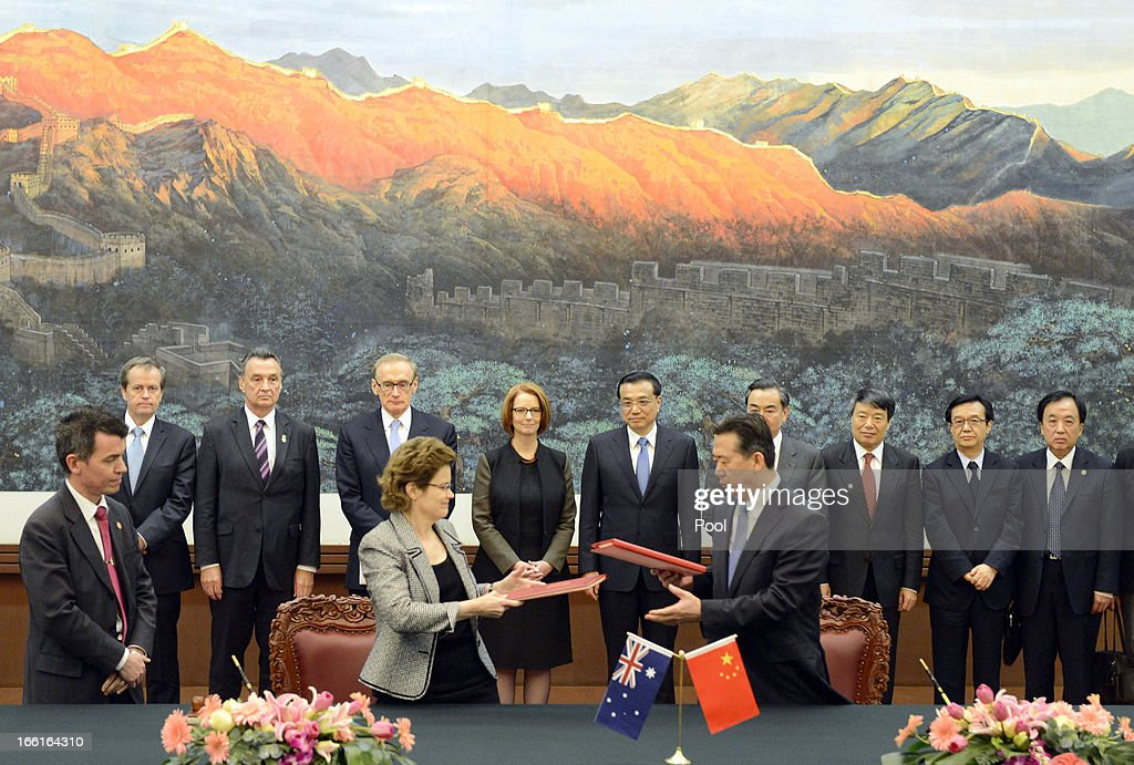 Australian Prime Minister Julia Gillard (6th L) stands with Chinese Premier Li Keqiang during a signing ceremony during a meeting at the Great Hall of the People on April 9, 2013 in Beijing, China. Gillard spoke of building stronger defense ties with China.