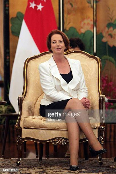 Australian Prime Minister Julia Gillard talks to acting Singapore President JY Pillay at the Istana on April 23 2012 in Singapore Gillard is visiting...