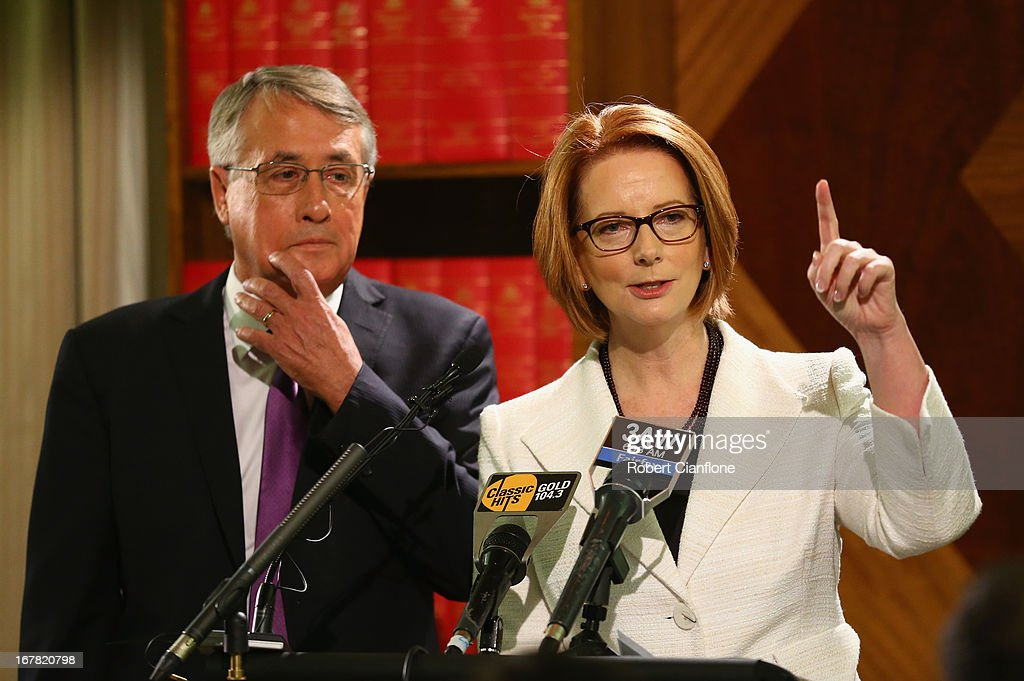 Australian Prime Minister <a gi-track='captionPersonalityLinkClicked' href=/galleries/search?phrase=Julia+Gillard&family=editorial&specificpeople=787281 ng-click='$event.stopPropagation()'>Julia Gillard</a> talks to the media as Treasurer <a gi-track='captionPersonalityLinkClicked' href=/galleries/search?phrase=Wayne+Swan&family=editorial&specificpeople=4582809 ng-click='$event.stopPropagation()'>Wayne Swan</a> looks on during a press conference at the Commonwealth Parliamentary Office on May 1, 2013 in Melbourne, Australia.