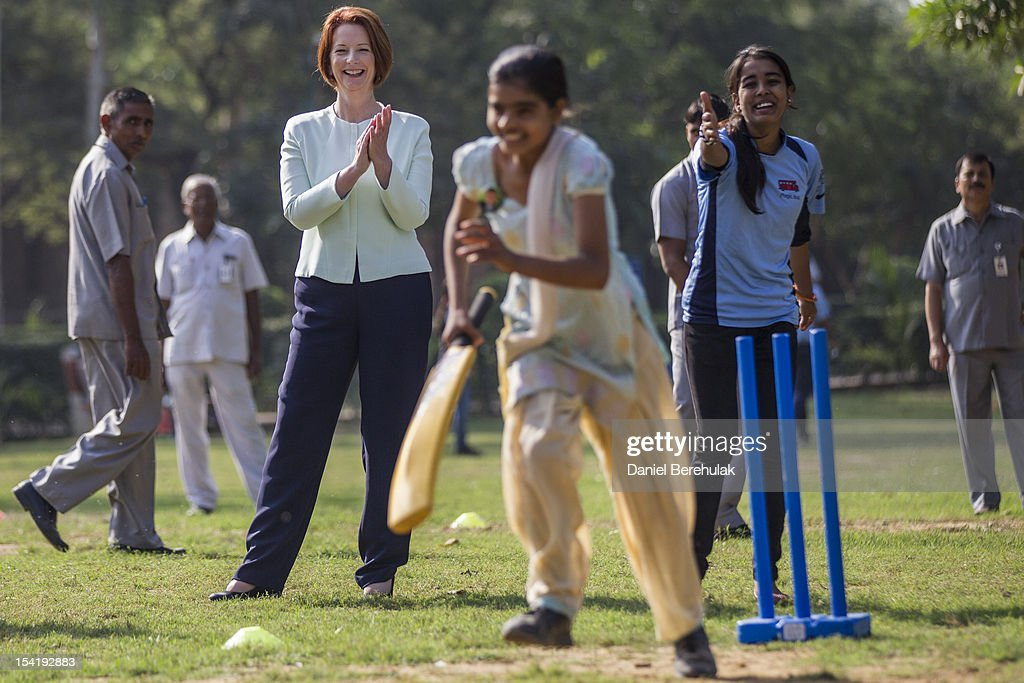 Australian Prime Minister <a gi-track='captionPersonalityLinkClicked' href=/galleries/search?phrase=Julia+Gillard&family=editorial&specificpeople=787281 ng-click='$event.stopPropagation()'>Julia Gillard</a> watches as children play cricket at a cricket clinic hosted by NGO Magic Bus NGO, which helps underprivileged children, on October 16, 2012 in New Delhi, India. Gillard is on an official three day visit to India.
