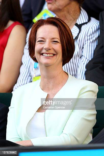 Australian Prime Minister Julia Gillard watches the women's final match between Maria Sharapova of Russia and Victoria Azarenka of Belarus during day...