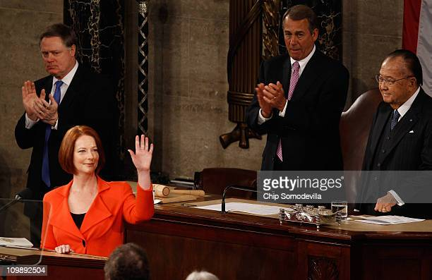 Australian Prime Minister Julia Gillard waves after addressing a joint meeting of the US Congress from the floor of the House of Representatives with...