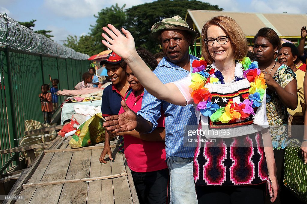 Australian Prime Minister Julia Gillard waves to the public during a tour of the Gerehu Market on May 10, 2013 in Port Moresby, Papua New Guinea. The three-day visit is a chance for the two nations to strengthen economic ties, with talks being held on key issues including, trade, military defense, and the controversial Australian detention center on Manus Island. The trip is the first official visit for Prime Minister Julia Gillard to the Pacific Island Nation and the first visit since former prime minster Kevin Rudd visited in 2007.