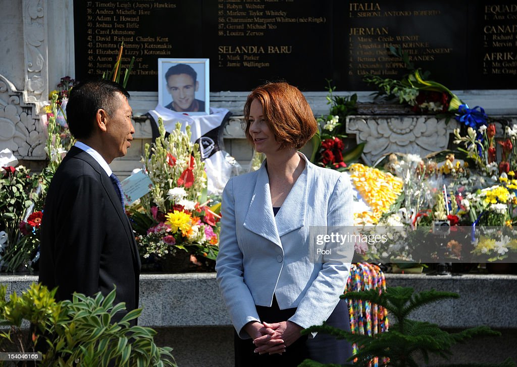 Australian Prime Minister <a gi-track='captionPersonalityLinkClicked' href=/galleries/search?phrase=Julia+Gillard&family=editorial&specificpeople=787281 ng-click='$event.stopPropagation()'>Julia Gillard</a> with Bali governor Made Mangku Pastika visits the 2002 Bali bombings memorial monument on the Indonesian resort island of Bali on October 13, 2012 in Kuta, Indonesia. Hundreds of survivors and relatives of the dead on October 12 paid tearful tributes to the 202 people killed in the Bali bombings 10 years ago.