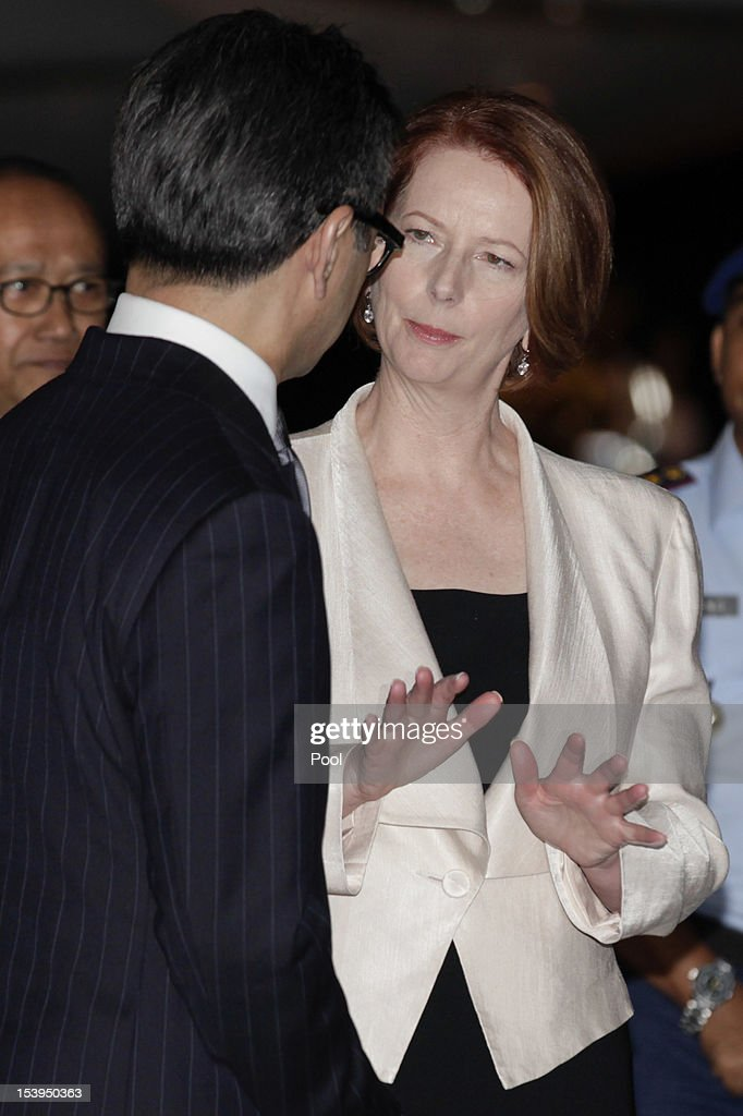 Australian Prime Minister Julian Gillard talks to Indonesian Foreign Minister <a gi-track='captionPersonalityLinkClicked' href=/galleries/search?phrase=Marty+Natalegawa&family=editorial&specificpeople=2862416 ng-click='$event.stopPropagation()'>Marty Natalegawa</a> after arriving in Bali to attend the Bali Memorial Service 2012 at Ngurah Rai Bali International Airport on October 11, 2012 in Kuta, Bali, Indonesia. The 2002 blast, killed 202 people, including 88 Australians and was blamed on the militant group Jemaah Islamiyah.