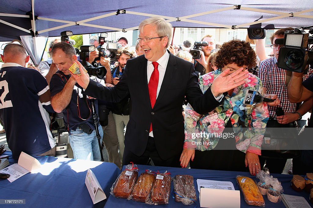 Australian Prime Minister Kevin Rudd and his wife Therese Rein buy cakes at a stall after voting at St Paul's Church in the seat of Griffith on...