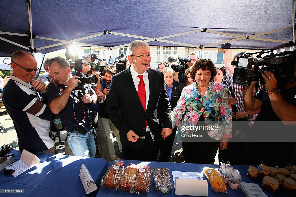 Australian Prime Minister Kevin Rudd and his wife Therese Rein talk to people at a cake stall after voting at St Paul's Church in the seat of...