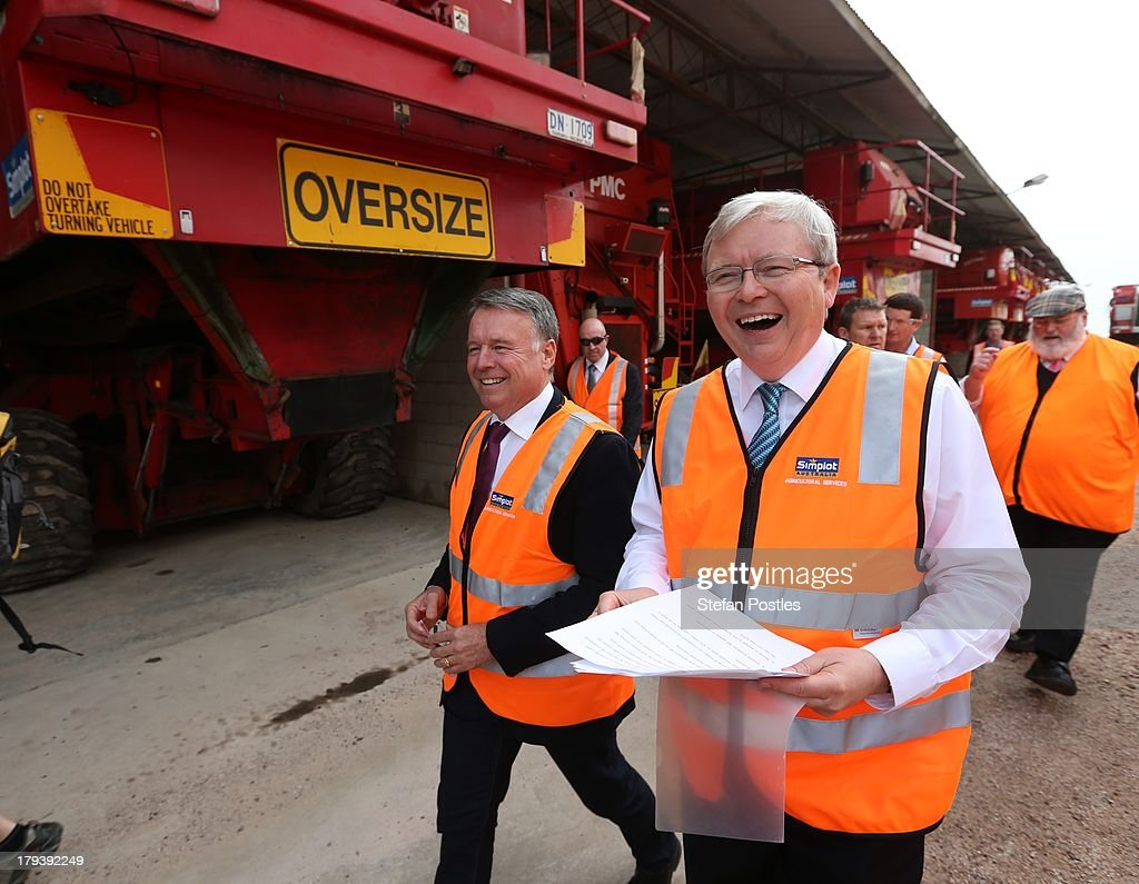 Australian Prime Minister <a gi-track='captionPersonalityLinkClicked' href=/galleries/search?phrase=Kevin+Rudd&family=editorial&specificpeople=707751 ng-click='$event.stopPropagation()'>Kevin Rudd</a> (R) and <a gi-track='captionPersonalityLinkClicked' href=/galleries/search?phrase=Joel+Fitzgibbon&family=editorial&specificpeople=4684655 ng-click='$event.stopPropagation()'>Joel Fitzgibbon</a> MP walk past a harvester as they tour the Simplot food processing centre on September 3, 2013 in Devenport, Australia. The Australian Labor Party hold four of the five seats in the island state, but all are considered vulnerable to falling to the Liberal-National Party coalition. Australian voters will head to the polls on September 7 to elect the 44th parliament.