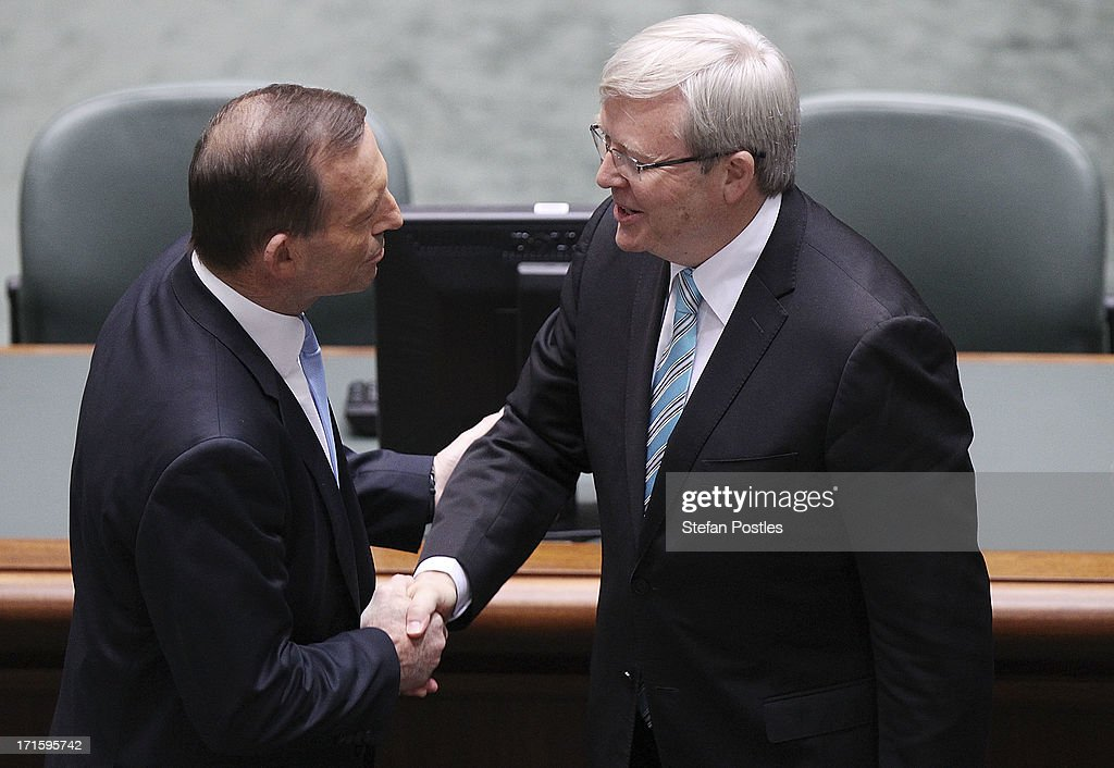 Australian Prime Minister Kevin Rudd and Opposition leader Tony Abbott shake hands in the House of Representatives on June 27 2013 in Canberra...