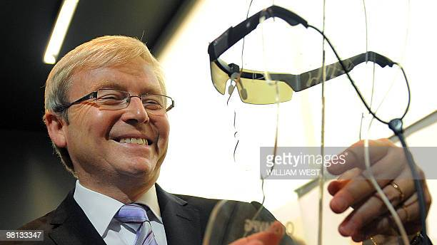 Australian Prime Minister Kevin Rudd inspects a prototype bionic eye which will deliver improved quality of life for patients suffering from...