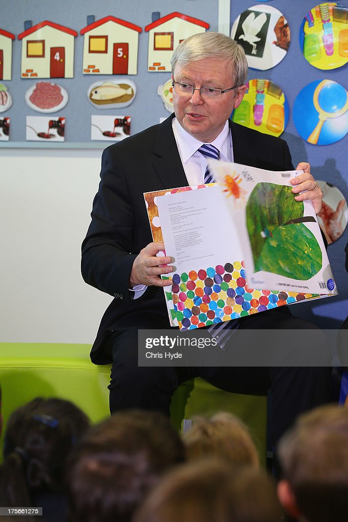 Australian Prime Minister Kevin Rudd reads to children during a visit to Brisbane Adventist College on August 6, 2013 in Brisbane, Australia. On day two of the 2013 election campaign Rudd made a funding announcement for transport in Brisbane, and addressed Rupert Murdoch's comments on the National Broadband Network.