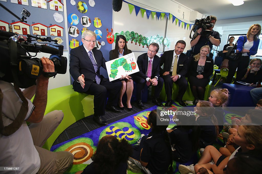 Australian Prime Minister Kevin Rudd reads to children during a visit to Brisbane Adventist College with Local member Laura Fraser Hardy and Minister for Education Bill Shorten on August 6, 2013 in Brisbane, Australia. On day two of the 2013 election campaign Rudd made a funding announcement for transport in Brisbane, and addressed Rupert Murdoch's comments on the National Broadband Network.