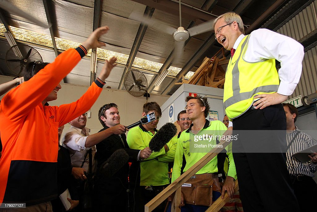 Australian Prime Minister Kevin Rudd speaks to workers in a factory on September 2 2013 in Gladstone Australia According to the News Limited Newspoll...