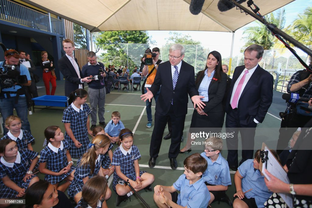 Australian Prime Minister Kevin Rudd talks to children during a visit to Brisbane Adventist College with Local member Laura Fraser Hardy and Minister for Education Bill Shorten on August 6, 2013 in Brisbane, Australia. On day two of the 2013 election campaign Rudd made a funding announcement for transport in Brisbane, and addressed Rupert Murdoch's comments on the National Broadband Network.