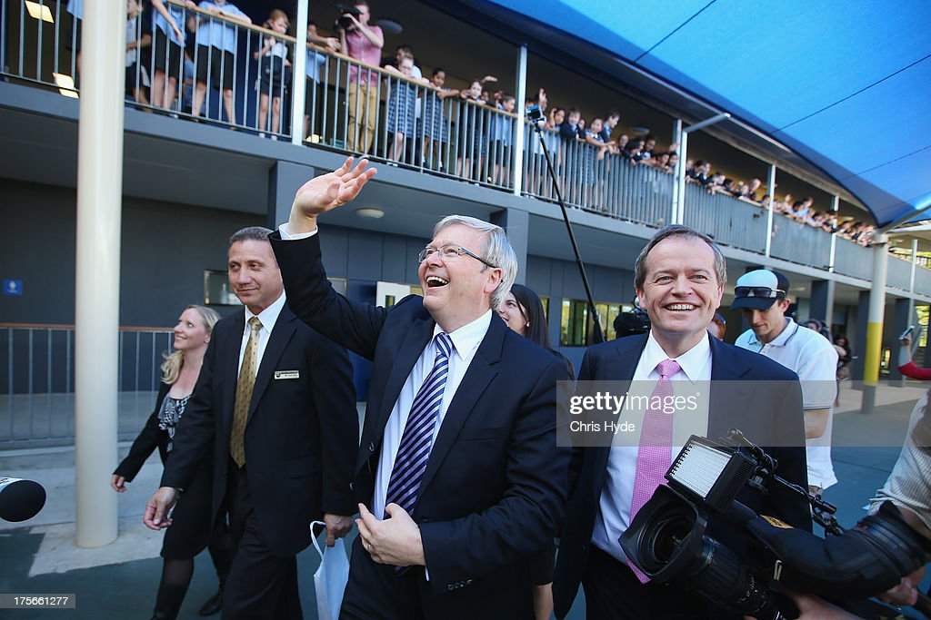 Australian Prime Minister <a gi-track='captionPersonalityLinkClicked' href=/galleries/search?phrase=Kevin+Rudd&family=editorial&specificpeople=707751 ng-click='$event.stopPropagation()'>Kevin Rudd</a> waves to children during a visit to Brisbane Adventist College with Local member Laura Fraser Hardy and Minister for Education Bill Shorten on August 6, 2013 in Brisbane, Australia. On day two of the 2013 election campaign Rudd made a funding announcement for transport in Brisbane, and addressed Rupert Murdoch's comments on the National Broadband Network.
