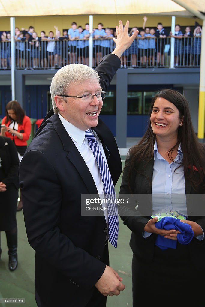 Australian Prime Minister Kevin Rudd waves to children during a visit to Brisbane Adventist College with Local member Laura Fraser Hardy on August 6, 2013 in Brisbane, Australia. On day two of the 2013 election campaign Rudd made a funding announcement for transport in Brisbane, and addressed Rupert Murdoch's comments on the National Broadband Network.