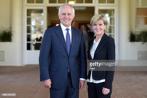 Australian Prime Minister Malcolm Turnbull and deputy leader of the LNP Julie Bishop pose for photographs after a swearingin ceremony at Government...