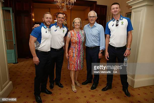 Australian Prime Minister Malcolm Turnbull and his wife Lucy pose with Steve O'Keefe and Jackson Bird during the Australian Test squad Kirribilli...