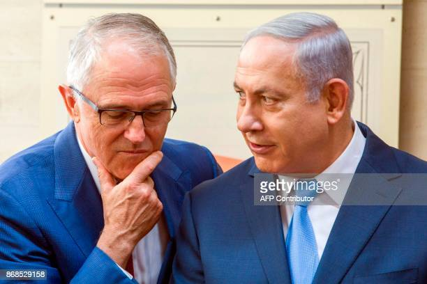 Australian Prime Minister Malcolm Turnbull and Israeli Prime Minister Benjamin Netanyahu chat during the opening of the new ANZAC museum at the...