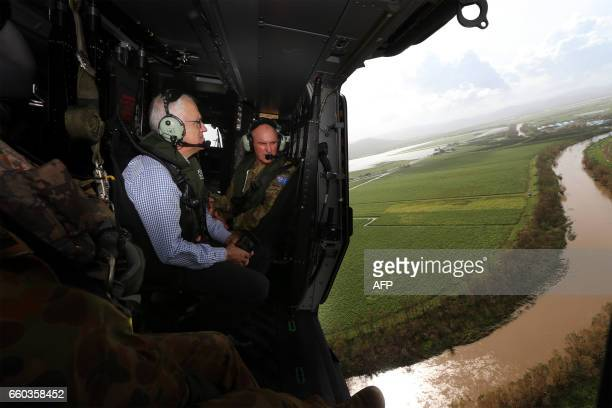 Australian Prime Minister Malcolm Turnbull examines the damage caused by Cyclone Debbie in an area of Bowen in northern Queensland by helicopter on...