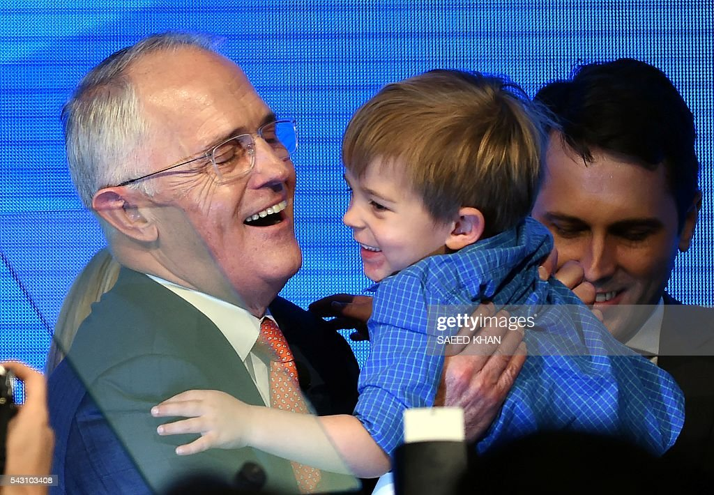 Australian Prime Minister Malcolm Turnbull holds his grandson Jack Turnbull-Brown following his address at the Coalition Campaign launch in Sydney on June 26, 2016. Turnbull used the chaos from Brexit to make a pitch for Australians to re-elect his coalition government, promising stability and strong economic leadership a week out from national polls to be held on July 2. / AFP / SAEED