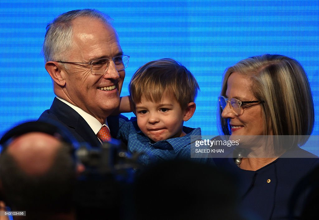 Australian Prime Minister Malcolm Turnbull holds his grandson Jack Turnbull-Brown with his wife Lucy following his address at the Coalition Campaign launch in Sydney on June 26, 2016. Turnbull used the chaos from Brexit to make a pitch for Australians to re-elect his coalition government, promising stability and strong economic leadership a week out from national polls to be held on July 2. / AFP / SAEED