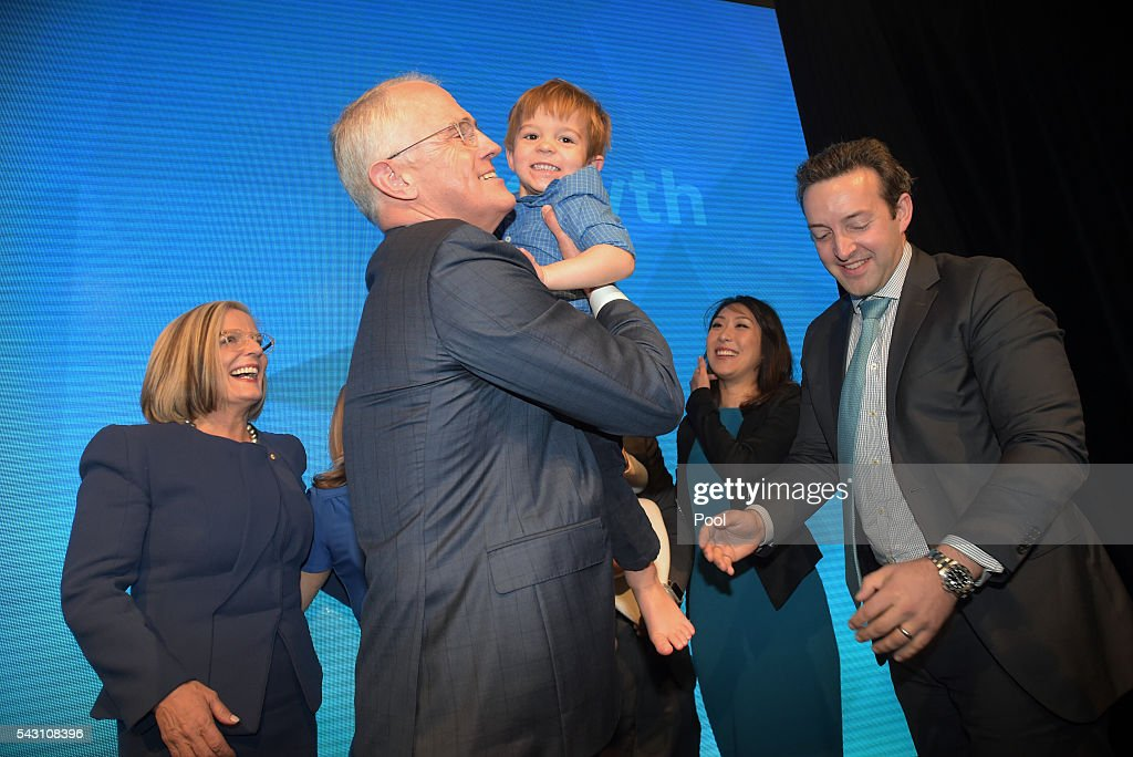 Australian Prime Minister Malcolm Turnbull is congratulated by his grandson Jack and other members of his family after addressing party members at the Coalition Campaign Launch in Sydney, Sunday, June 26, 2016. A federal election will be held in Australia on Saturday July 2.