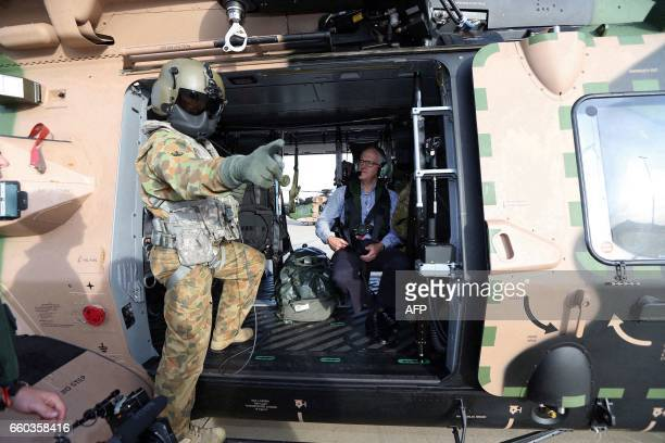 Australian Prime Minister Malcolm Turnbull is pictured in a military helicopter as he visits an area of Bowen in northern Queensland damaged by...