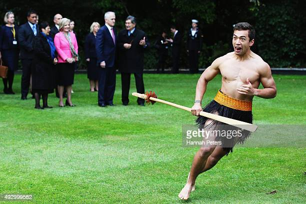 Australian Prime Minister Malcolm Turnbull is welcomed in an official ceremony by a Maori warrior at Government House on October 17 2015 in Auckland...