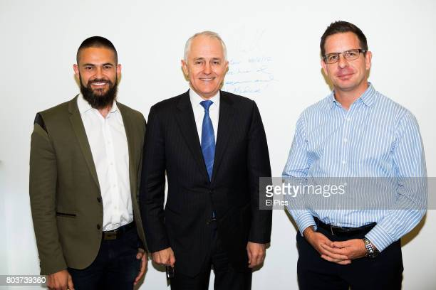 Australian Prime Minister Malcolm Turnbull poses with Tony Abrahams and Will Easton during the launch of AiMedia partnership with Facebook on June 30...