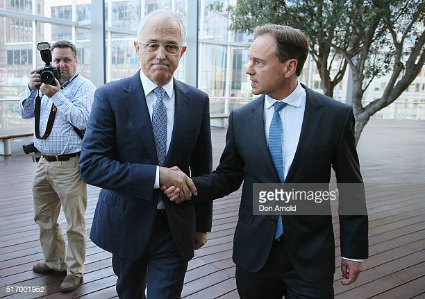 Australian Prime Minister Malcolm Turnbull shakes hands with Environment Minister Greg Hunt following a press conference on March 23 2016 in Sydney...