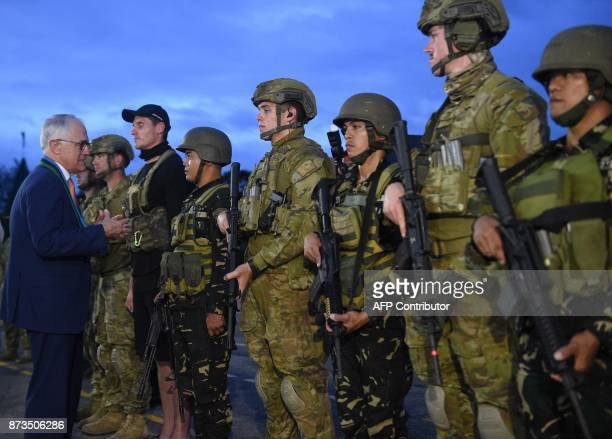Australian Prime Minister Malcolm Turnbull talks to Australian and Philippine soldiers after a antiterrorism simulation drill at the military...