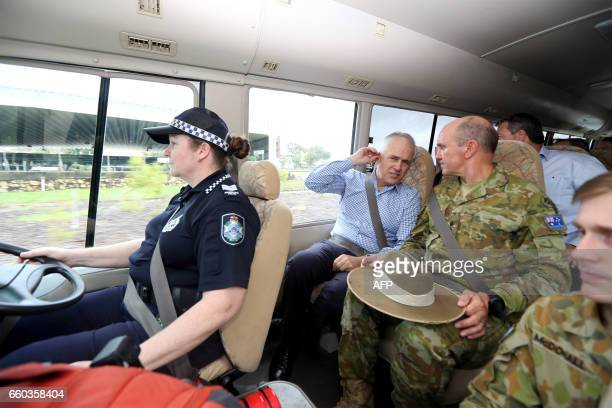 Australian Prime Minister Malcolm Turnbull visits an area of Bowen in northern Queensland damaged by Cyclone Debbie on March 30 2017 Torrential rain...