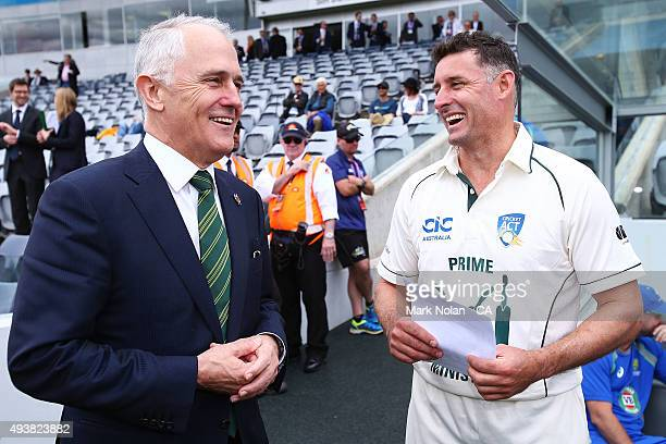 Australian Prime Minister Malcom Turnbull chats with Michael Hussey before the tour match between the Prime Minister's XI and New Zealand at Manuka...