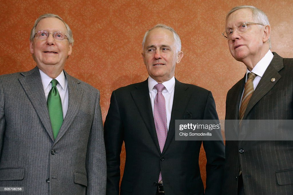 Australian Prime Minister Malcom Turnbull (C) poses for photographs with Senate Majority Leader <a gi-track='captionPersonalityLinkClicked' href=/galleries/search?phrase=Mitch+McConnell&family=editorial&specificpeople=217985 ng-click='$event.stopPropagation()'>Mitch McConnell</a> (R-KY) (L) and Senate Minority Leader <a gi-track='captionPersonalityLinkClicked' href=/galleries/search?phrase=Harry+Reid+-+Politician&family=editorial&specificpeople=203136 ng-click='$event.stopPropagation()'>Harry Reid</a> (D-NV) in the Strom Thurmond Room at the U.S. Capitol January 19, 2016 in Washington, DC. Turnbull met with the Republican leader after visiting the White House and meeting with U.S. President Barack Obama earlier in the day.
