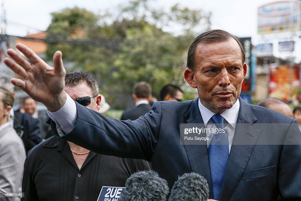 Australian Prime Minister Tonny Abbott talks with journalist at a press conference on October 9, 2013 in Kuta, Indonesia. Mr Abbott has announced the Victims of Overseas Terrorism Compensation Scheme will now include attacks dating back to September 10, 2001.