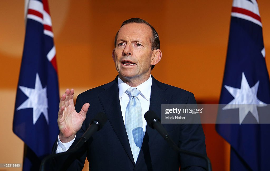 Australian Prime Minister <a gi-track='captionPersonalityLinkClicked' href=/galleries/search?phrase=Tony+Abbott&family=editorial&specificpeople=220956 ng-click='$event.stopPropagation()'>Tony Abbott</a> addresses the media during a press conference at Parliament House on July 18, 2014 in Canberra, Australia. 27 Australians were on board the Malaysia Airlines flight MH17 which was reportedly shot down over Eastern Ukraine. Reports that a surface-to-air missile brought the Boeing 777 down remain unconfirmed.