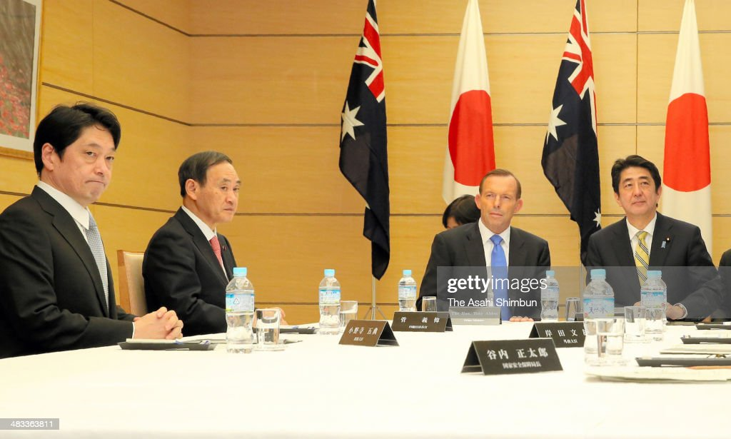 Australian Prime Minister <a gi-track='captionPersonalityLinkClicked' href=/galleries/search?phrase=Tony+Abbott&family=editorial&specificpeople=220956 ng-click='$event.stopPropagation()'>Tony Abbott</a> (2nd R), along with Japanese Prime Minister Shinzo Abe (1st R), Chief Cabinet Secretary <a gi-track='captionPersonalityLinkClicked' href=/galleries/search?phrase=Yoshihide+Suga&family=editorial&specificpeople=3868279 ng-click='$event.stopPropagation()'>Yoshihide Suga</a> (2nd L) and Defense Minister <a gi-track='captionPersonalityLinkClicked' href=/galleries/search?phrase=Itsunori+Onodera&family=editorial&specificpeople=2547583 ng-click='$event.stopPropagation()'>Itsunori Onodera</a>, attends Japan's special meeting of the National Security Council at Abe's official residence on April 7, 2014 in Tokyo, Japan. Japan and Australia agreed to start negotiations on a defense equipment and technology tie-up with an eye on countering China's maritime advances. Abbott is on tour to Japan, South Korea and Japan.