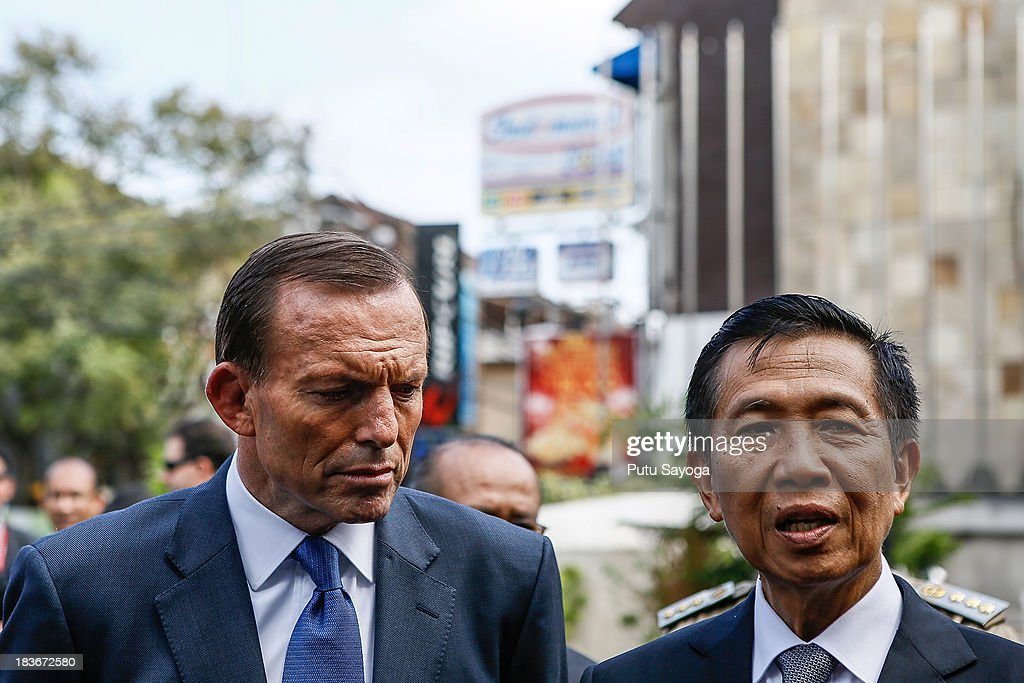 Australian Prime Minister <a gi-track='captionPersonalityLinkClicked' href=/galleries/search?phrase=Tony+Abbott&family=editorial&specificpeople=220956 ng-click='$event.stopPropagation()'>Tony Abbott</a> (L) and Bali Governor Made Mangku Pastika (R) talk with journalist at a press conference on October 9, 2013 in Kuta, Indonesia. Mr Abbott has announced the Victims of Overseas Terrorism Compensation Scheme will now include attacks dating back to September 10, 2001.