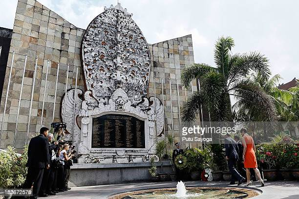 Australian Prime Minister Tony Abbott and his wife Maggie Abbott visit the Bali bombing memorial site on October 9 2013 in Kuta Indonesia Mr Abbott...